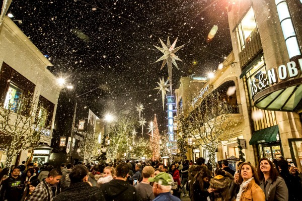 Holiday shoppers stop to experience the Magic of Snow at The Grove in Los Angeles, CA.