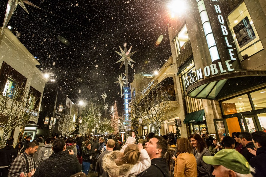 Guests enjoy the special effects snow show at The Grove in Los Angeles, CA.